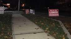 Republican and Democratic campaign signs left over from