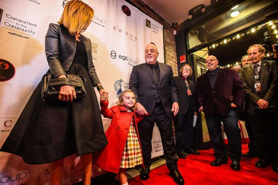 Billy Joel is led onto the red carpet