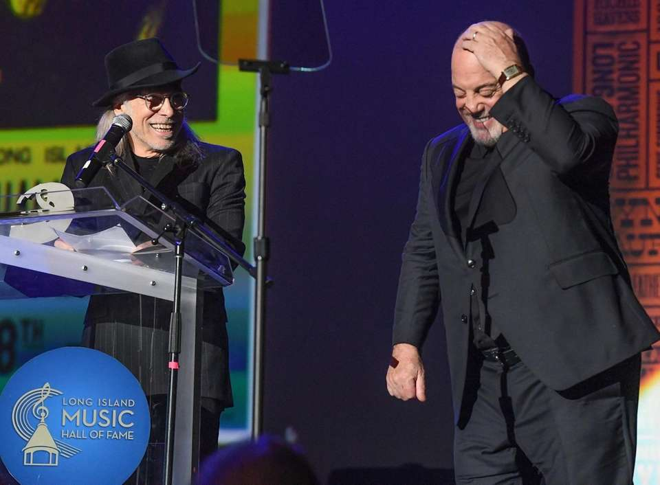 Billy Joel, right, inducts Elliott Murphy, left, into