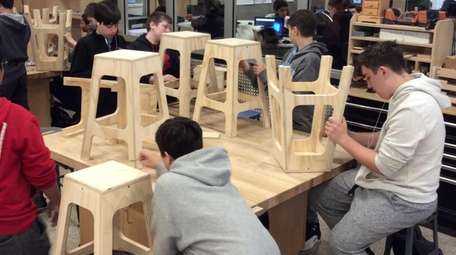 Mineola High School students create wooden stools in