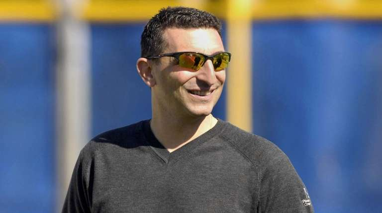 Then-Blue Jays general manager J.P. Ricciardi watches during