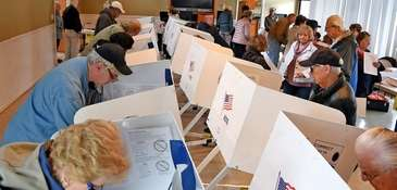 Voters mark their ballots in last week's election