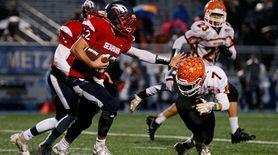 Jarell Brown #7 of East Rockaway tackles Raymond