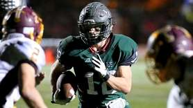 Westhampton Beach FB Liam McIntyre carries the ball