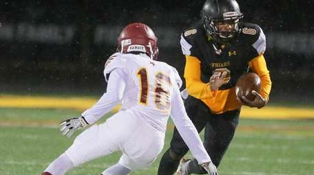 St Anthony's Makhai Murphy (6) looks to get
