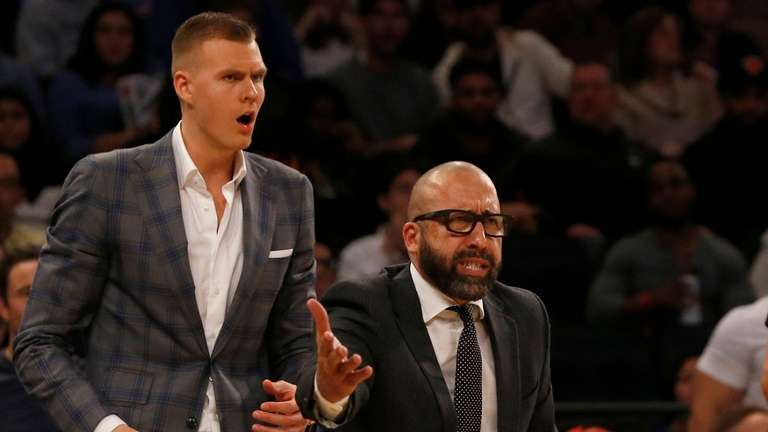 KIncks coach David Fizdale and Kristaps Porzingis react