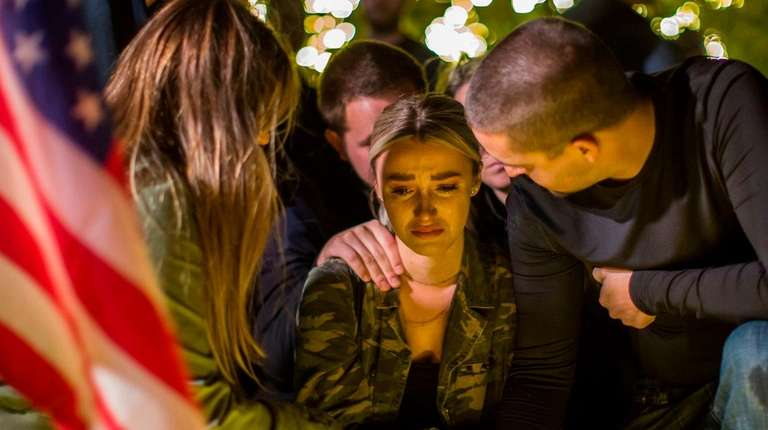 Mourners hold a vigil to pay tribute to