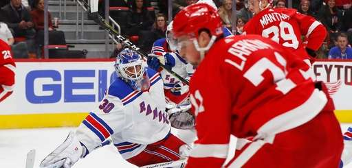 New York Rangers goalie Henrik Lundqvist (30) reaches
