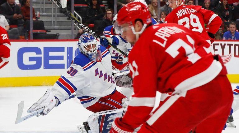 New York Rangers goalie Henrik Lundqvist (30) reaches