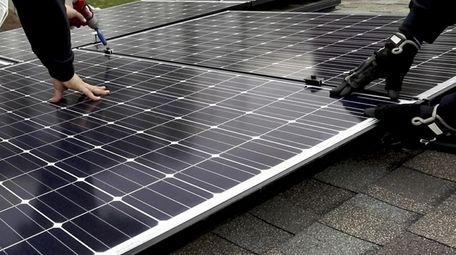 installation of solar panels on Nov. 14, 2017.