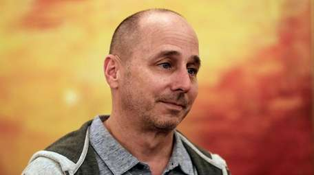 Yankees general manager Brian Cashman speaks to reporters