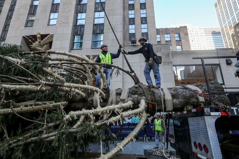 Workers prepare to hoist up the 2018 Rockefeller