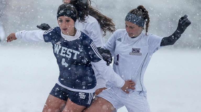 Smithtown West's Emily Leverich under pressure from Monroe-Woodbury's