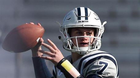 Charlie McKee #7, Oceanside freshman quarterback, throws a