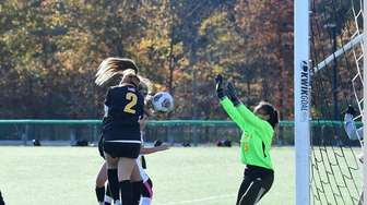 Maddie Paccione of St. Anthony's scores a goal
