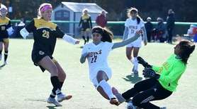 Samantha Adams of St. Anthony's kicks the ball
