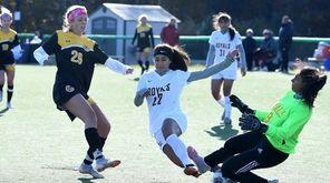 Samantha Adams of St. Anthony's kicks the ball