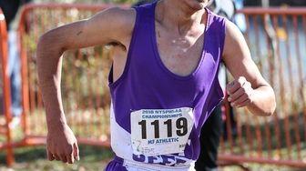 Grant Samara of Port Jefferson crosses the finish