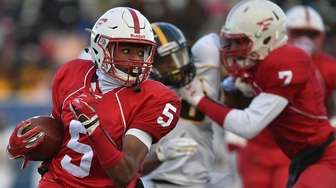 Jordan Jackson #2 of Freeport rushes for a