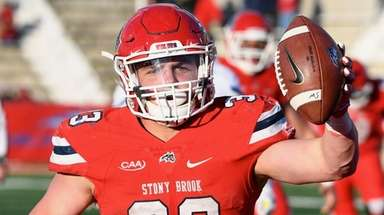Stony Brook running back Donald Liotine reacts after