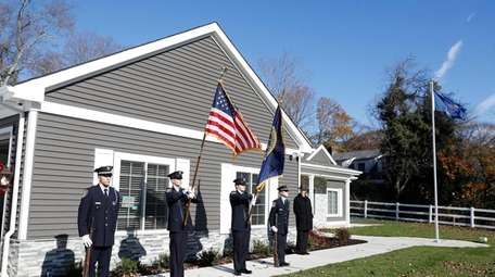 An honor guard outside the new customized home