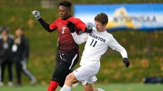 Amityville's Kymani Hines, left, is defended by Brighton's