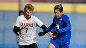Port Washington's Andrew Sichiani, right, is defended by