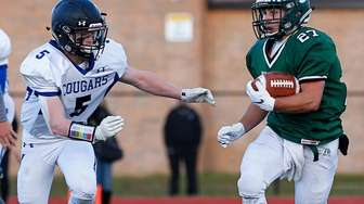 Mike Anderson #27 of Lindenhurst runs the ball