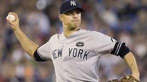 New York Yankees starting pitcher Javier Vazquez throws