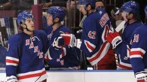 The Rangers' Michael Del Zotto celebrates with teammates