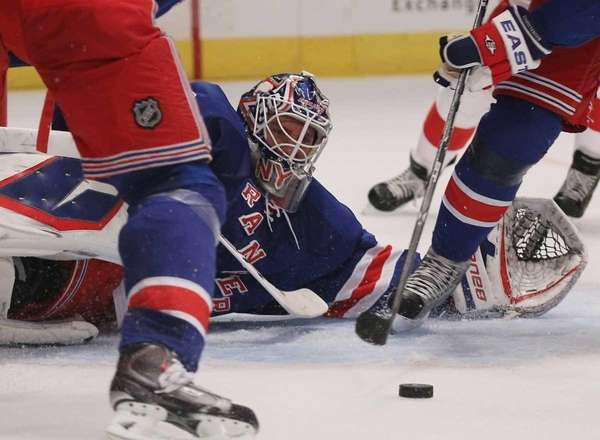 The Rangers' Henrik Lundqvist makes a save against
