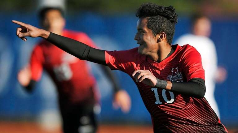 Amityville's Henry Martinez celebrates his first goal during