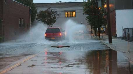 Flooding on First Street makes the road hard