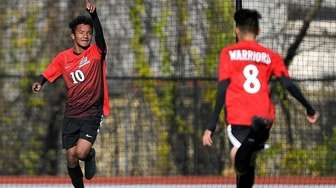 Amityville's Henry Martinez celebrates his second goal during