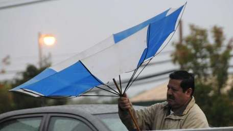 A man nearly loses his umbrella in Patchogue