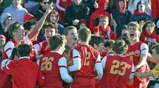 Chaminade celebrates defeating Regis in the CHSAA state