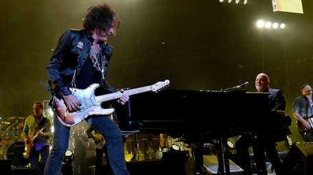 Joe Perry performs with Billy Joel at Madison