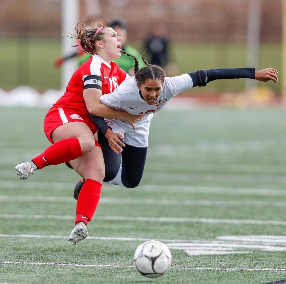 Valley Stream South's Mia Asenjo collides with Jamesville-Dewitt's
