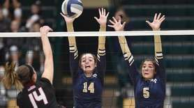 Shannon Carey #14 of Bayport-Blue Point, center, and