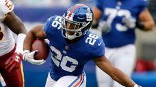 Giants running back Saquon Barkley runs a reception