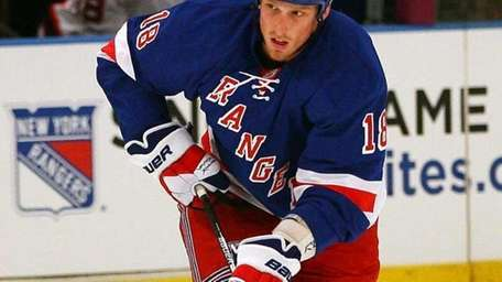 The Rangers' Marc Staal skates with the puck