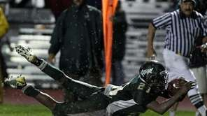 Floyd's Stacey Bedell dives for extra yardage after