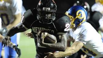 Newfield's Shervon Barthelmy scores against Comsewogue in the