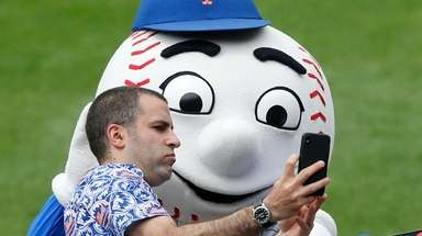 Mr. Met interacts with fans at Citi Field