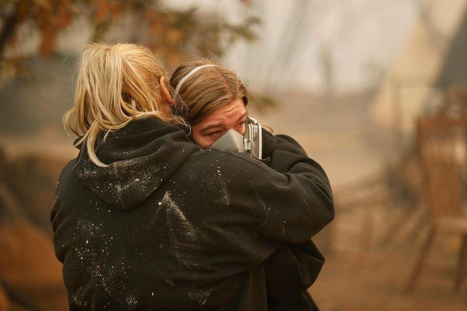 Krystin Harvey, left, comforts her daughter Araya Cipollini