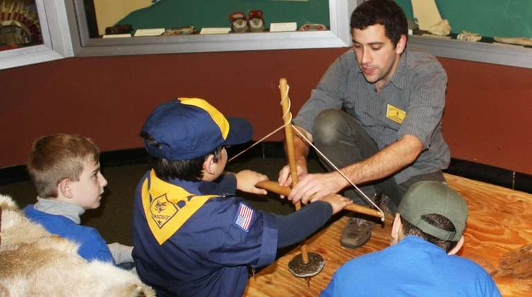 Children learn how to use a replica of