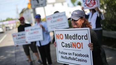 Loretta Nastasi of Medford protests during an anti-casino