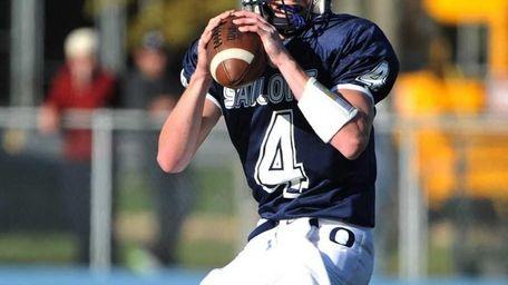Oceanside Sailors quarterback Tyler Heuer (4) drops back