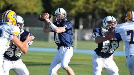 Oceanside Sailors quarterback Tyler Heuer (4) drops back