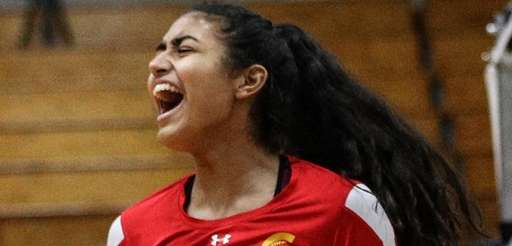 Sacred Heart's Olivia DeJesus celebrates a point against